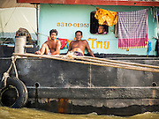 15 OCTOBER 2014 - BANGKOK, THAILAND:  People on a barge hauling freight up the Chao Phraya River through Bangkok.   PHOTO BY JACK KURTZ