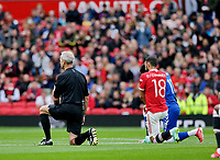 Football - 2021 / 2022 Pre-Season Friendly - Manchester United vs Everton - Old Trafford - Saturday 7th August 2021<br /> <br /> Match refereee Martin Atkinson and Bruno Fernandes of Manchester United take the knee before the kick off, at Old Trafford.<br /> <br /> COLORSPORT/ALAN MARTIN