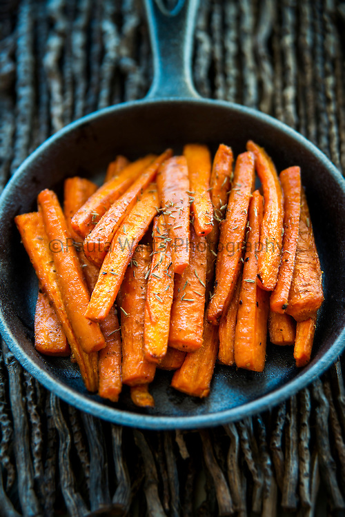 Roasted carrots in cast iron skillet for seasonal fall side dish