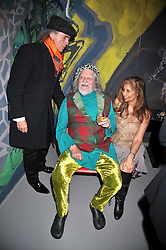 Left to right, DAVID SHILLING, The MARQUESS OF BATH and TRUDIE JUGGERNAUTH-SHARMA at a party to celebrate the opening of Topolski Century held at The Arches, Hungerford Bridge, London SE1 on 16th March 2009.