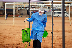 ALEXANDRA SOUTH AFRICA - APRIL 25: A health worker during intensified testing and screening on Freedom Day, screening and testing includes people over over 60, flu-like symptoms, comorbid conditions, like diabetes, asthma, hypertencsion, HIV and tuberculosis on April 25, 2020 in Alexandra South Africa. Under pressure from a global pandemic. President Ramaphosa declared a 21 day national lockdown extended by another two weeks, mobilising goverment structures accross the nation to combat the rapidly spreading COVID-19 virus - the lockdown requires businesses to close and the public to stay at home during this period, unless part of approved essential services. (Photo by Dino Lloyd)