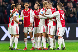 13-03-2019 NED: Ajax - PEC Zwolle, Amsterdam<br /> Ajax has booked an oppressive victory over PEC Zwolle without entertaining the public 2-1 / Dusan Tadic #10 of Ajaxscores 1-0, Noussair Mazraoui #12 of Ajax, Kasper Dolberg #25 of Ajax, Daley Blind #17 of Ajax, Donny van de Beek #6 of Ajax, Lasse Schone #20 of Ajax