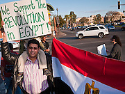 31 JANUARY 2011 - TEMPE, AZ:  A man carries his son during a demonstration in Tempe, AZ, in support of democracy in Egypt Monday. About 200 people marched through central Tempe, AZ, near the Arizona State University campus Monday afternoon. The rally was organized by the Arab American Association of Arizona in solidarity with the ongoing pro-democracy rallies and demonstrations in Egypt and other Arab countries.    Photo by Jack Kurtz