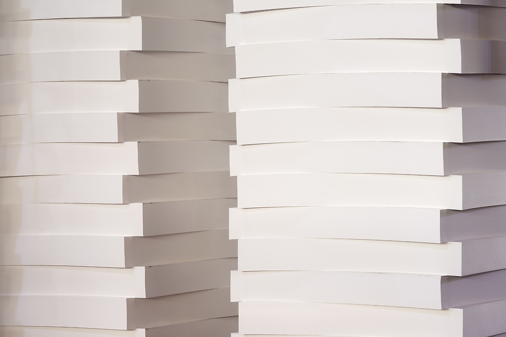 A stack of blank paper in a printing warehouse