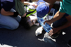 Wednesday 26 October 2016.<br /> Parliament, Cape Town,<br /> Western Cape,<br /> South Africa<br /> <br /> Fees Must Fall Protest March In Cape Town.<br /> <br /> An injured student lies on the ground after falling in front of a Police Nyala armoured vehicle shortly after almost getting driven over while protesting outside Parliament in Cape Town.<br /> <br /> Students and supporters march to parliament in protest against higher education fees in South Africa on the 26th October 2016. The students are protesting against the fees for higher education. This protest is part of the #FeesMustFall campaign.<br /> <br /> Picture By: Mark Wessels/ RealTime Images.