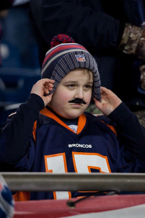 Foxborough, MA 01/14/2012.Oliver Bednarczuk wear his Wes Welker mustache during the first half of Saturday's AFC Divisional game between the New England Patriots and the Denver Broncos..Wicked Local Photo by Alex Jones