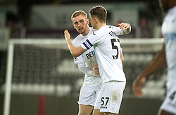 SWANSEA, WALES - Tuesday, January 10, 2017: Swansea City's Oliver McBurnie celebrates the first equalising goal against Wolverhampton Wanderers with team-mate Keston Davies [R] during the Football League Trophy 3rd Round match at the Liberty Stadium. (Pic by Gwenno Davies/Propaganda)
