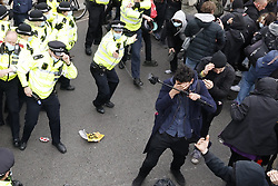 © Licensed to London News Pictures. 03/04/2021. London, UK. A police officer sprays pepper spray as scuffles break out  in Parliament Square in central London during a 'Kill the Bill' demonstration and rally. A coalition of groups including Extinction Rebellion, Kill the Bill & Black Lives Matter are coming together over the Easter weekend to campaign against the proposed Police, Crime, Sentencing and Courts Bill which will give police in England and Wales more power to impose conditions on non-violent protests. Photo credit: Peter Macdiarmid/LNP