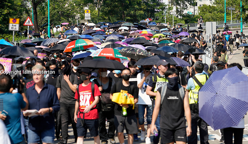 Tuen Mun, Hong Kong. 22 September 2019. Pro democracy demonstration and march through Tuen Mun in Hong Kong. Marchers protesting against harassment by sections of the pro Beijing community. Largely peaceful march had several violent incidents with police using teargas. Several arrests were made. Iain Masterton/Alamy Live News