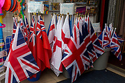 English and British flags on sale for a few Pounds outside a seaside trinket shop, on 14th July 2017, at Scarborough, North Yorkshire, England.