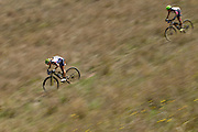 Sally Bigham and Ester Suss of Team Meerendal try to catch Team RECM2 during stage 6 of the 2014 Absa Cape Epic Mountain Bike stage race from Oak Valley Wine Estate in Elgin, South Africa on the 29 March 2014<br /> <br /> Photo by Greg Beadle/Cape Epic/SPORTZPICS