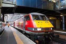 Virgin Trains locomotive from London King's Cross on East Coast Main line  at platform at Waverley Station in Edinburgh, Scotland, United Kingdom