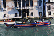 Boat moving tourist luggage, Grand Canal, Venice, Italy...Subject photograph(s) are copyright Edward McCain. All rights are reserved except those specifically granted by Edward McCain in writing prior to publication...McCain Photography.211 S 4th Avenue.Tucson, AZ 85701-2103.(520) 623-1998.mobile: (520) 990-0999.fax: (520) 623-1190.http://www.mccainphoto.com.edward@mccainphoto.com.