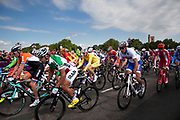 London, UK. Saturday 28th July 2012. On Putney Bridge in London, the peloton of riders in the Men's Team Road Race pass.