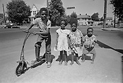 Y-610803B-16.  Black kids on N. Vancouver & Stanton. Believed to be Walter Johnson on scooter. August 3, 1961