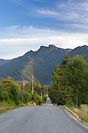 A rural road during a summer evening in the Ryder Lake area of Chilliwack, British Columbia, Canada.  Church Mountain is in the background.