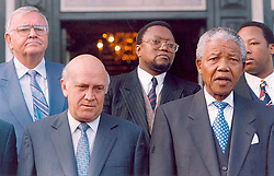 Nelson Mandela at his presidential inauguration with his deputy, FW de Klerk.