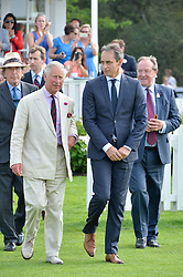 Left to right, HRH THE PRINCE OF WALES and ANDRE KONSBRUCK Director of Audi UK at the Audi International Polo at Guards Polo Club, Windsor Great Park, Egham, Surrey on 26th July 2014.