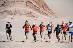 © Licensed to London News Pictures. 14/11/2013.<br /> <br /> The runners go for a training run on a giant sand dune in La Valle de la muerte (The valley of death). <br /> <br /> Inaugural Volcano Marathon, Atacama Desert, Chile. The race took place in the Atacama Desert in Chile, beginning at an altitude of 4,400 metres (14,500 feet) in the vicinity of Lascar Volcano. It was a gruelling affair for many of the competitors who had to encounter some challenging hills and manage the impact of the heat and oxygen deprivation. The average altitude of the entire race was close to 4,000 metres and temperatures reached the mid 20s Celsius, or almost 80 Degrees Farenheit.<br /> <br /> Photo credit : Mike King/LNP<br /> <br /> Further information and link to video here: https://www.dropbox.com/s/0277bepxvo0t8il/Marathon%20copy.txt