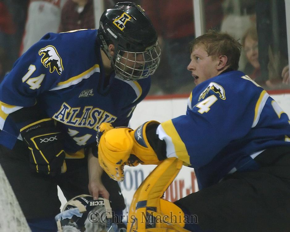 11/3/06 Omaha, NE  University  of Alaska's Brandon Gawryletz takes to goalie Wylie Rogers at Qwest Center Omaha..(Chris Machian/Prairie Pixel Group)..