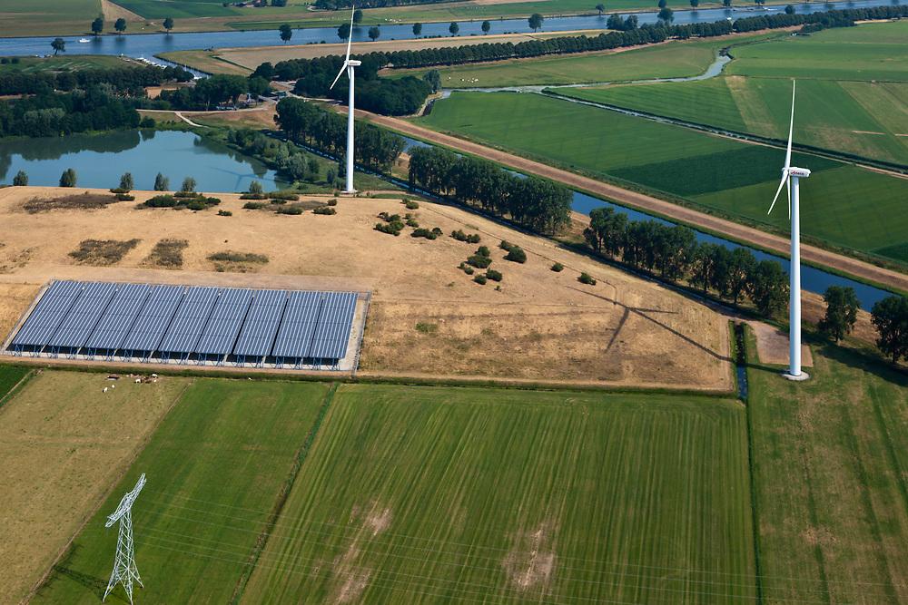 Nederland, Noord Brabant, Gemeente Waalwijk, 08-07-2010. Ecopark Waalwijk (Eneco), voormalige stortplaats Gansoyensesteeg. In het park combinatie van drie verschillende vormen van duurzame energie: zonne-energie-, windenergie en stortgas energie (biogas). <br /> Ecopark Waalwijk, former landfill. In the park three different forms of renewable energy: solar energy, wind energy and landfill gas (biogas).<br /> luchtfoto (toeslag), aerial photo (additional fee required)<br /> foto/photo Siebe Swart.