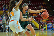 March 18, 2016; Tempe, Ariz;  Green Bay Phoenix forward Mehryn Kraker (10) drives past Tennessee Lady Volunteers guard Te'a Cooper (20) during a game between No. 7 Tennessee Lady Volunteers and No. 10 Green Bay Phoenix in the first round of the 2016 NCAA Division I Women's Basketball Championship in Tempe, Ariz.