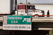 19 DECEMBER 2008 -- NOGALES, SON, MEX: Nicolas Antonio Garcia Castro, a Mexican truck driver, walks along the line of trucks waiting to enter the US on the Mexican side of the Mariposa port of Entry in Nogales.  PHOTO BY JACK KURTZ