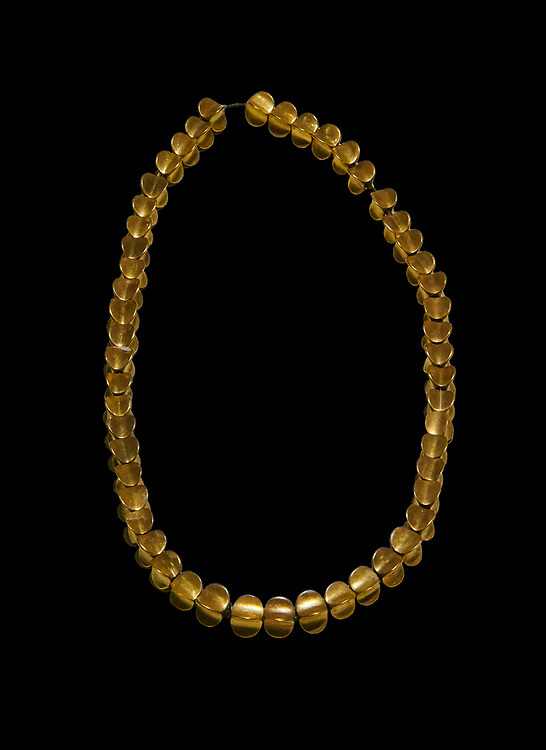 Bronze Age Hattian gold necklace from Grave L,  possibly a Bronze Age Royal grave (2500 BC to 2250 BC) - Alacahoyuk - Museum of Anatolian Civilisations, Ankara, Turkey. Against a black background .<br /> <br /> If you prefer to buy from our ALAMY PHOTO LIBRARY  Collection visit : https://www.alamy.com/portfolio/paul-williams-funkystock/royal-tombs-alaca-hoyuk-bronze-age.html (TIP refine search by adding background colour in the LOWER search box)<br /> <br /> Visit our ANCIENT WORLD PHOTO COLLECTIONS for more photos to download or buy as wall art prints https://funkystock.photoshelter.com/gallery-collection/Ancient-World-Art-Antiquities-Historic-Sites-Pictures-Images-of/C00006u26yqSkDOM