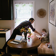 Arts journalist and critic, Andy Smith, gets his daughter, Elliot's, breakfast ready.