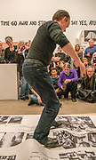 """Portland, Oregon, USA. 26 FEB, 2018. A performance artist shreds photographer Robert Frank's work with ice skates at Blue Sky Gallery in Portland, Oregon, USA. The work was destroyed in a """"Destruction Dance"""" performance defacing the photographs with ink and mutilation with scissors, knives and even ice skates  at the end of it's run. The destruction was Frank's protest regarding today's greed in the global art market."""
