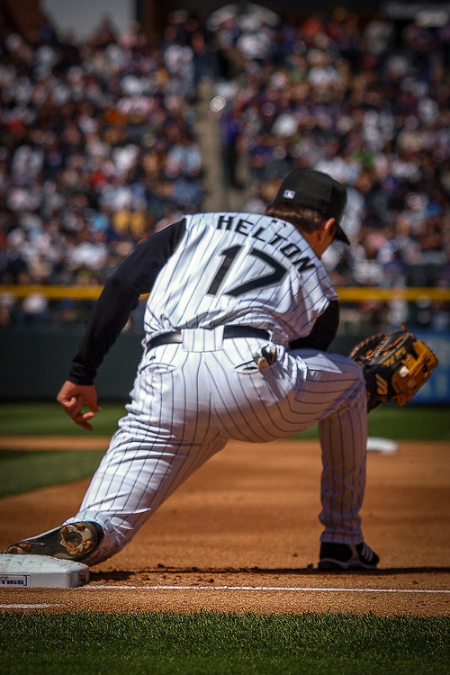 TODD HELTON scoops a ball at first base.