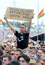 A festivalgoer holds a sign as he watches Royal Blood on The Pyramid Stage at the Glastonbury Festival, at Worthy Farm in Somerset.