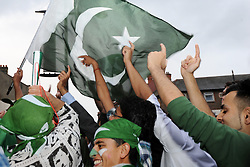 © Licensed to London News Pictures. 14/08/2013. Upton Park, London. People celebrate Pakistan Independence Day. Photo credit: David Mirzoeff/LNP