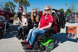 Karen Davidson with (left to right) Ashley Sutherland, Reagan Imhoff (MDA's 2014 National Goodwill Ambassador) and Skyler Keim-Jones as the Women's MDA Fundraiser Ride arrives at Destination Daytona during Daytona Bike Week. FL, USA. March 11, 2014.  Photography ©2014 Michael Lichter.