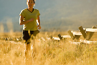 A young woman runs along a trail in Grand Teton National Park, Jackson Hole, Wyoming.