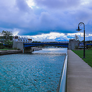"""Charlevoix Drawbridge 2""<br /> <br /> Beautiful blue waters and dark skies as you walk towards the drawbridge in Charlevoix Michigan!"