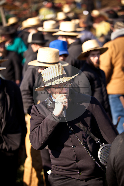 Amish auctioneer during the Annual Mud Sale to support the Fire Department  in Gordonville, PA.