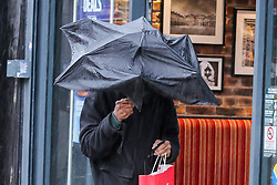 © Licensed to London News Pictures. 02/10/2020. London, UK. A man struggles to control his umbrella in north London as Storm Alex arrives from Europe. The Met Office forecasts heavy rain and windy weather for the next few days in the capital, caused by Storm Alex. Photo credit: Dinendra Haria/LNP