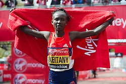 © London News Pictures. 22/04/2012. London, UK. Mary Keitany of Kenya celebrates winning the women's elite race during the 2012 Virgin London Marathon on April 22, 2012. Photo credit : Ben Cawthra /LNP