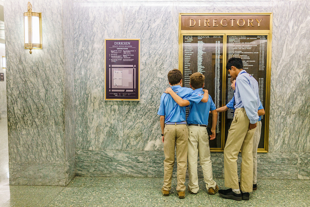 Washington, D.C. - October 07, 2016: Members of the Hyperbolics look for Senator Bernie Sanders's office on the Dirksen Senate Office Building directory.<br /> <br /> The Hyperbolics are a First Lego League team based out of Sterling School in Greenville SC, who made a trip to DC ask government officials to ban lead wheel weights Friday October 7, 2016.<br /> <br /> <br /> CREDIT: Matt Roth for Earthjustice