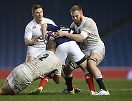 James Chisholm (Harlequins) tackles Antoine Dupont during the 2015 Under 20s 6 Nations match between England and France at the American Express Community Stadium, Brighton and Hove, England on 20 March 2015.