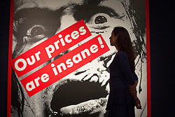 © licensed to London News Pictures. London, UK 21/06/2013. 'Our prices are insane' by Barbara Kruger estimated to be sold for £200-300 in Christie's upcoming Post-War & Contemporary Art Evening Auction which will take place on June 25, 2013. Auction features with works by Basquiat, Doig, Liechtenstein and Warhol and total estimate is £56-72 million. Photo credit: Tolga Akmen/LNP