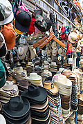 Vendor selling hats Benito Juarez market in Oaxaca, Mexico.