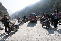 Regrouping after a water crossing on day-4 of our  Himalayan Heroes adventure riding from Pokhara to Kalopani, Nepal. Friday, November 9, 2018. Photography ©2018 Michael Lichter.