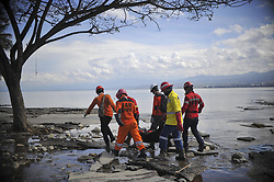 Oct. 8, 2018 - Post, Sulawesi, Indonesia - Members of Indonesian search and rescue team carry a plastic bag containing a dead body in Poso of Central Sulawesi province. The death toll from multiple strong quakes and an ensuing tsunami in Indonesia's Central Sulawesi province jumped to 1,944 as the search and rescue operation is expected to be completed on Thursday. (Credit Image: © Zulkarnain/Xinhua via ZUMA Wire)