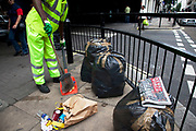 "The last ever copy of tabliod newspaper News of The World as a street cleaner cleans up the day's rubbish. Sunday 10th July 2011 saw the end for this most famous of newspapers. Embroiled in the phone hacking scandal, this News International paper had approximately 7 million readers at the time of it's demise. On the cover of this, the final edition, with examples of previous journalistic success the headline simply read ""Thank You & Goodbye""."