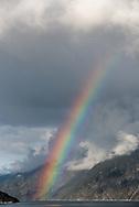 A rainbow appears along Chilkoot Inlet near Haines, Alaska