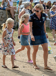 Autumn Phillips walks with her daughters Savannah (centre) and Isla (left) on the second day of the Festival of British Eventing at Gatcombe Park, Gloucestershire.