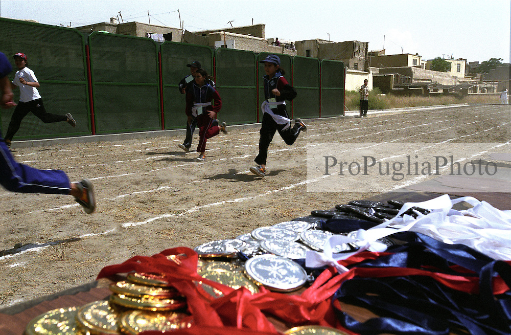 KABUL 24 August 2005..Bagh-e-Zanana, girls games..Afghan girls run for the 25 Meters Competition...On 23-25 August 2005, Special Olympics Afghanistan held its first national Games at Olympic Stadium in Kabul. ..More than 300 athletes, including 80 female athletes, experienced a taste of happiness and achievement for the first time in their lives. They competed in athletics, bocce and football (soccer). Because of cultural restrictions, males and females competed at separate venues.