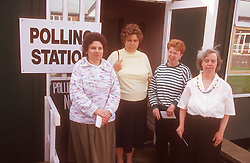 Group of women with learning difficulties standing outside polling station after voting in local elections,